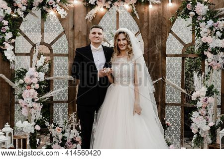 The Groom With The Bride On The Photozone. Wedding Photo Zone. Holiday Of A Young Couple.