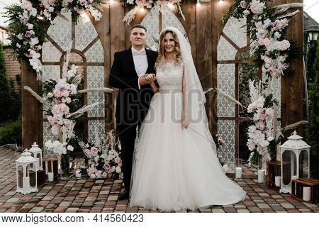 The Groom With The Bride On The Photozone. Wedding Photo Zone. Holiday Of A Young Couple.two Hearts