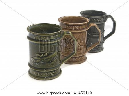 Three Old Ceramic Cup On White Background Isolated