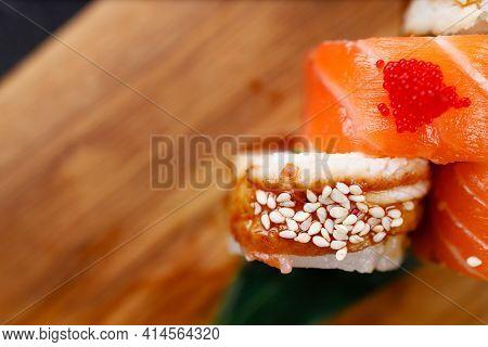 Salmon And Eel Unagi Sushi Rolls On Serving Board