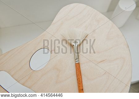 Paintbrush On Wood Palette. Painter Palette. Wooden Palette With Brushes Close Up