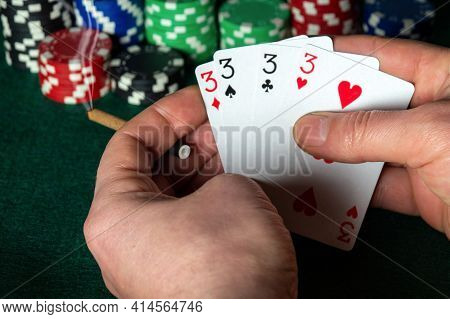 Poker Cards With Four Of A Kind Or Quads Combination. Close Up Of A Gambler Hands Is Holding Playing
