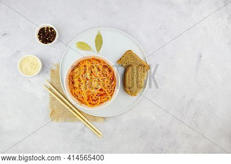 Spicy Pickled Carrots In A Bowl On A Grey Background, Spicy Korean Appetizer. Vegan Healthy Food.