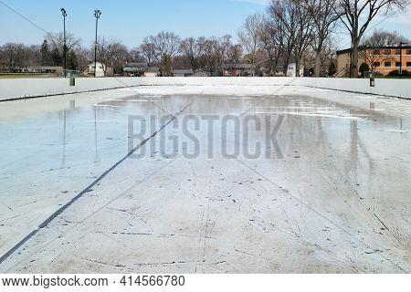 A hockey rink in a local park melts as spring arrives.