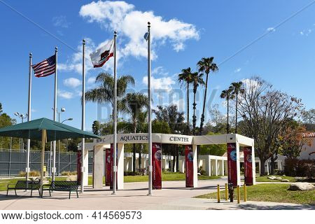PASADENA, CALIFORNIA - 26 MAR 2021: Flags an banners at the entrance to the Rose Bowl Aquatics Center in Brookside Park.