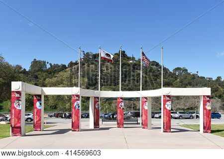 PASADENA, CALIFORNIA - 26 MAR 2021: Flags and banners at the Rose Bowl Aquatics Center in Brookside Park.