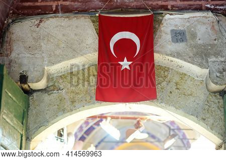 Turkish Flag On The Wall Of Grand Bazaar In Istanbul, Turkey. Travel, Tourism And Sightseeing Spots