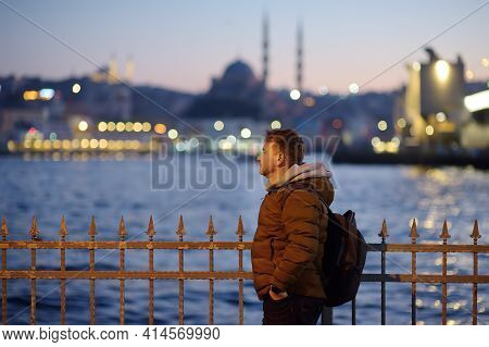 Handsome Man On A Coast Of The Golden Horn Bay In Istanbul, Turkey In The Evening. Suleymaniye Mosqu