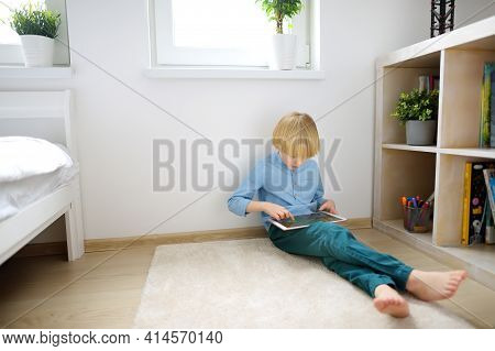 Preschooler Boy Playing Pc Game By Tablet. Overuse And Addiction Kids From Gadgets. Digital Device A