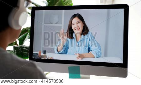 Young Asian Woman Greeting Her Friend By Virtal Video Conference At Home, Social Distancing, Telecom