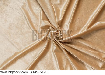 Colored Brown Textile Satin Fabric Folded In Folds And Waves With Highlights And Texture