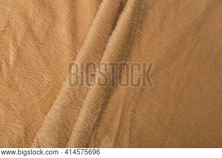 Colored Brown Textile Satin Fabric Folded In Folds And Waves With Highlights And Texture Shimmers In