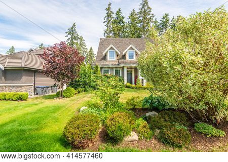 Fragment of a house with gorgeous outdoor landscape in suburbs of Vancouver, Canada