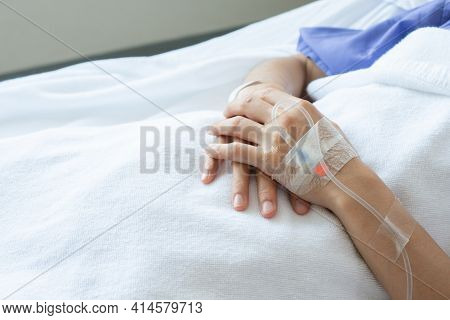 Cropped Shot Of Patient Hand Receiving Intravenous Fluid Directly Into A Vein.