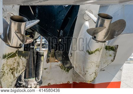 Closeup Of Silver Props On Twin Outboard Boat In Dry Dock.