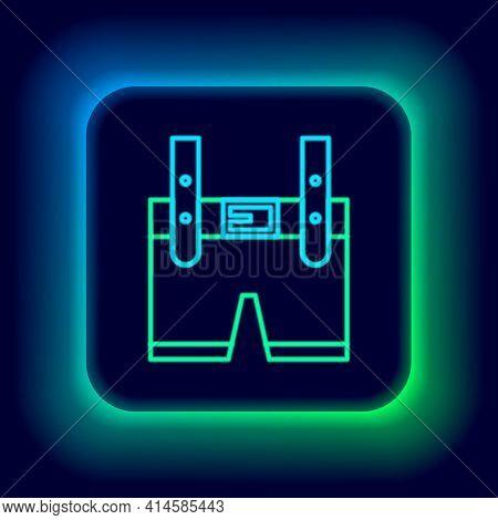 Glowing Neon Line Lederhosen Icon Isolated On Black Background. Traditional Bavarian Clothing. Oktob