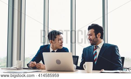 Two Business People Talk Project Strategy At Office Meeting Room. Businessman Discuss Project Planni