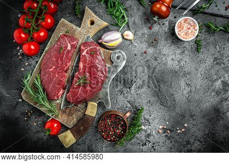 Uncooked Beef Steaks With Rosemary. Dry Aged Steak With Herbs And Salt. American Meat Restaurant. Ba