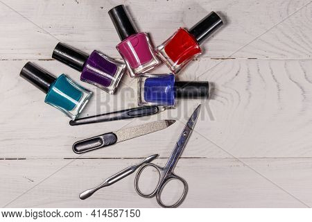 Basic Set Of Manicure Tools On White Wooden Background. Nail And Cuticle Scissors, Cuticle Trimmer,