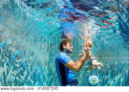 Happy People Dive Underwater With Fun. Funny Photo Of Father, Child In Aqua Park Swimming Pool. Fami