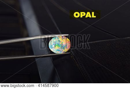 Opal Ring It Is White Gold Decorated With A Large Round Opal. Placed On The Keyboard