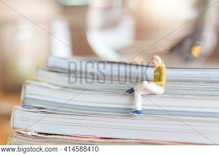 Miniature People Woman Wearing Headphones And Listening To Music On Smartphone