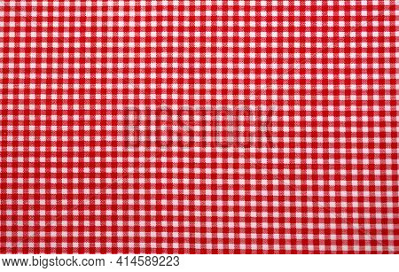 Red And White Checkered Tablecloth. Top View Table Cloth Texture Background. Red Gingham Pattern Fab