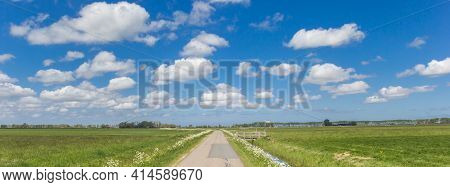 Panorama Of A Narrow Coutry Road In The Dutch Landscape Near Groningen, Netherlands