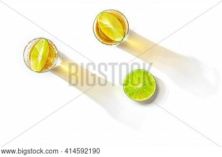 Tequila Shots With Salty Rims And Lime Slices, Overhead Flat Lay Shot