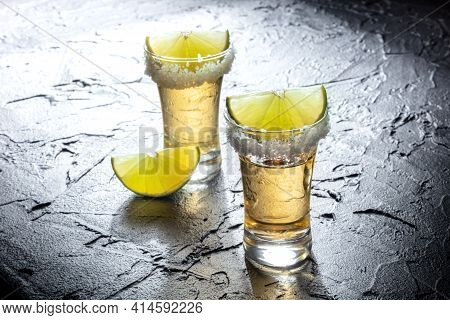Tequila Shots With Salted Rims And Lime Slices