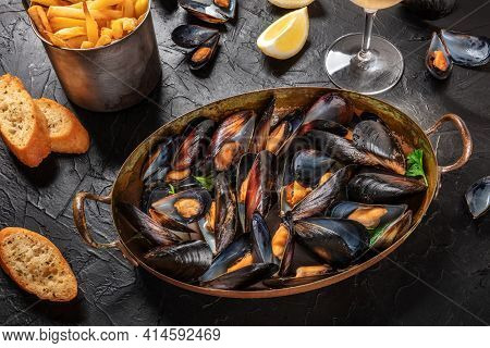 Moules Frites, Mussels With Fries, With Lemon And Toasts