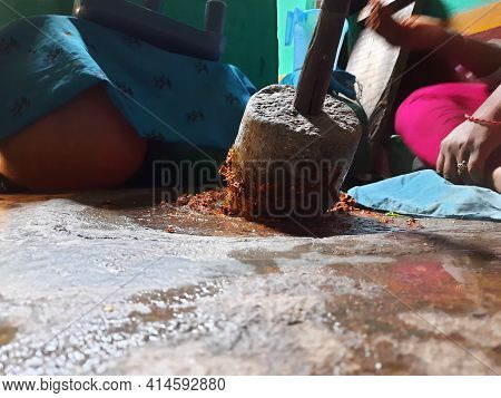Closeup Indian Girl Grinding Masala Or Chutney In A Traditional Way Using Grinding Stones
