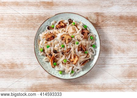 Konjac Pasta With Mushrooms And Green Peas, A Healthy Low-calorie Dinner