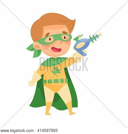 Cute Boy Wearing Cape And Mask As Superhero Holding Water Pistol Pretending Having Power For Fightin
