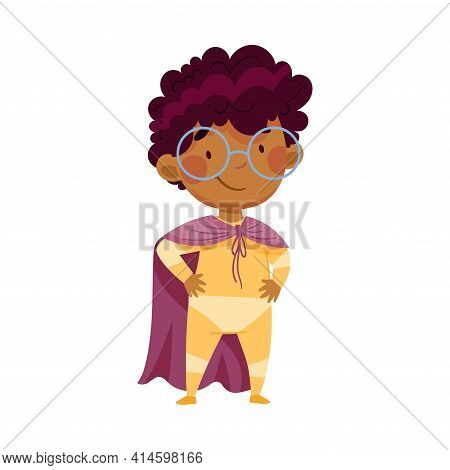 Pretty African American Boy Wearing Cape As Superhero Standing With His Hands On Hips Pretending Hav