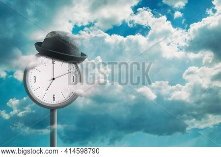 Street Clock, In A Hat, Against The Backdrop Of A Cloudy Sky. Planning Concept. Time Management. Lac