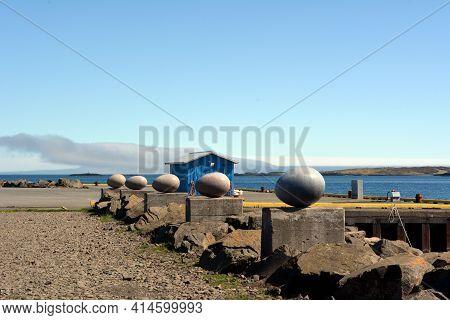 Stone Bird Eggs On The Seafront In Djupivogur In Iceland. Summer 2017