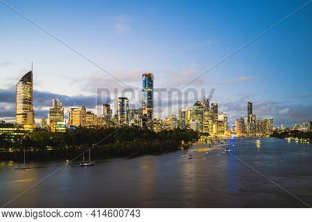 Brisbane Skyline By Brisbane River At Night, Capital Of Queensland, Australia