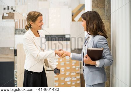 Businesswoman Owning Small Business Tiles Store. She Is Handshaking With A Satisfied Customer.