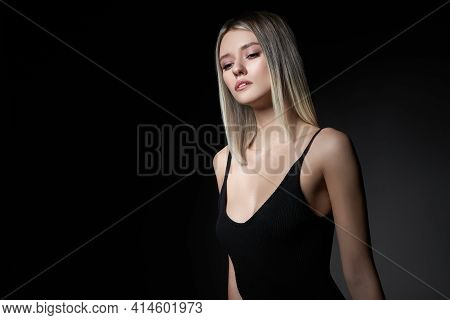 Woman With Colored Hair Color Of A Blonde On Black Background. Coloring Hair Woman Model In Ash Colo