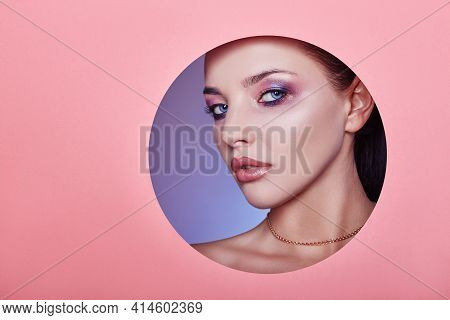 Beautiful Plump Lips Bright Pink Color, Woman Looks In Circle Hole Colored Pink Paper, Beauty Salon.