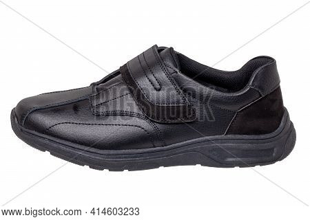 Mans Black Shoes. Close-up Of A Single Black Sneaker Or Sport Shoe Isolated On A White Background. E