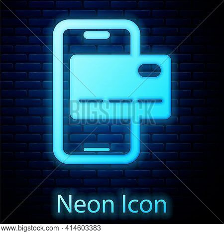 Glowing Neon Mobile Banking Icon Isolated On Brick Wall Background. Transfer Money Through Mobile Ba