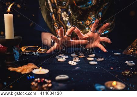 The Female Hands Of The Soothsayer Read The Runes. The Concept Of Divination, Astrology And Predicti