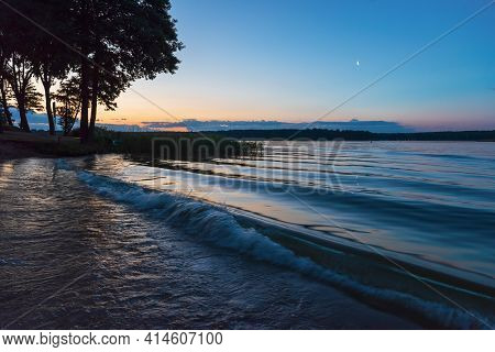 Calm Lake And Sand Shore With Trees And Dark Blue Sky, Tranquil Nature Landscape At Night