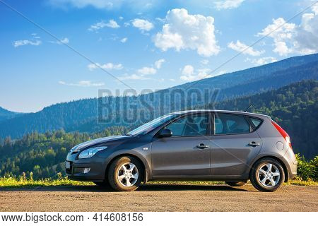 Mizhhirya, Ukraine - Aug 08, 2020: Car On The Concrete Parking On Top Of The Mountain In Morning Lig