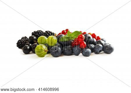 Mix Berries Isolated On White Background. Blueberry, Currant, Gooseberry And Blackberry With Copy Sp