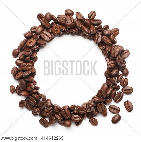 Coffee Beans Forming A Ring Shape For Copy Space Over White Background