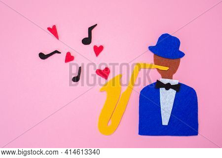 International Jazz Day. A Silhouette Of A Musician With A Saxophone From Which Hearts And Melodies F