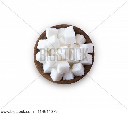 Wooden Bowl With White Sugar Cubes. Sugar Cube Isolated On White. Selective Focus. Sugar Cube In Woo